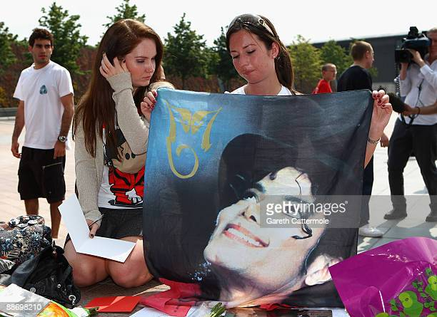 Fans gather to lay tributes to Michael Jackson outside the O2 Arena where Jackson was to perform 50 sell out nights starting next month on June 26,...