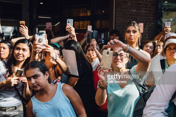 Fans gather to meet Paris Hilton during a promotion visit to Australia to launch her 23rd fragrance Rosé Rush on November 30 2017 in Sydney Australia