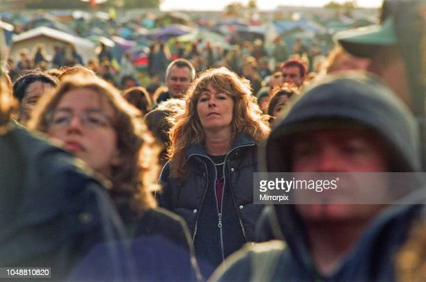 Fans gather to watch The The on stage at Glastonbury 23rd June 2000.