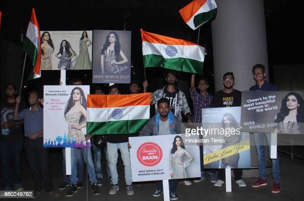 Fans gather to welcome as Miss World winner Manushi Chhillar arrives at Chhatrapati Shivaji International Airport on November 26 2017 in Mumbai India...