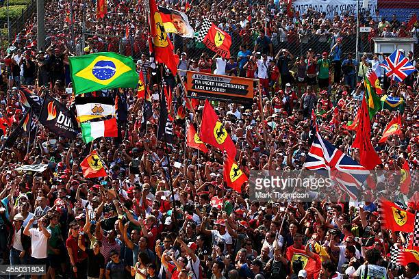 Fans gather under the podium following the F1 Grand Prix of Italy at Autodromo di Monza on September 7 2014 in Monza Italy