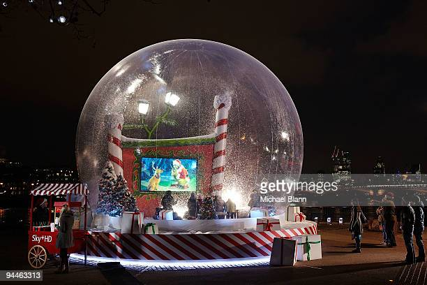 Fans gathered for a festive high definition screening of The Grinch in a giant snow globe on the South Bank on December 14 2009 in London England The...