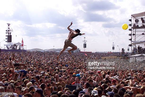 Fans get air with the music of the east stage at the site of Woodstock 99 in Rome New York The Woodstock 99 30th Anniversary Concert takes place on...