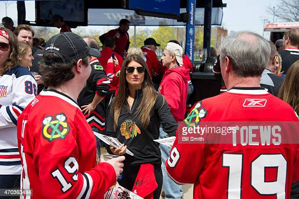 Fans get autographs from an IceCrew girl outside of the United Center prior to Game Three of the Western Conference Quarterfinals between the...