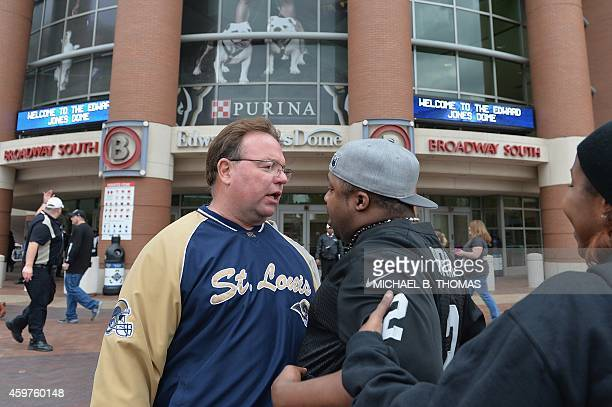 Fans get into a minor scuffle related to protests in downtown St Louis Missouri on November 30 2014 Demonstrators marched through the streets of St...