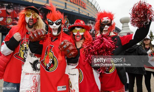 Fans get into the spirit prior to the start of the game between the Ottawa Senators and the Boston Bruins in Game One of the Eastern Conference First...