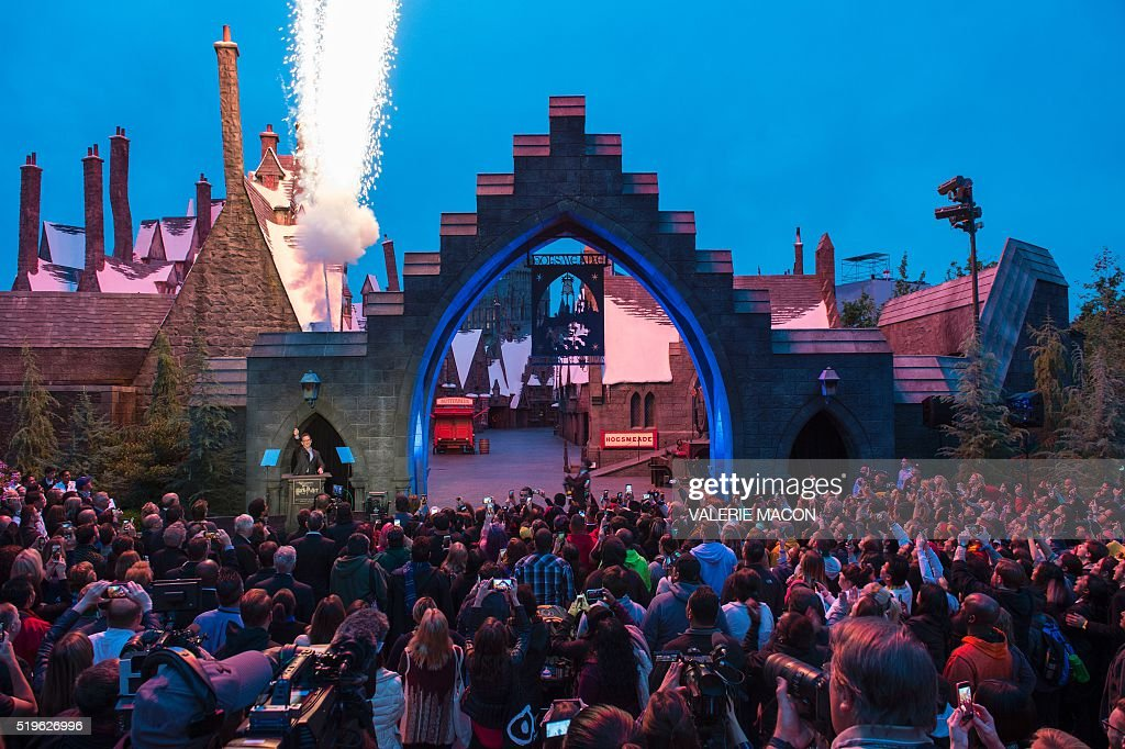 Fans get ready to enter Hogsmeade at the Grand Opening of the Wizarding World of Harry Potter to the public at Universal Studios Hollywood, in Universal City, California, on April 7, 2016. Fifteen years after Harry Potter's first big screen adventure, Universal is enchanting a new generation of Muggles with its most spectacular conjuring trick yet -- a theme park in the heart of Hollywood. / AFP / VALERIE