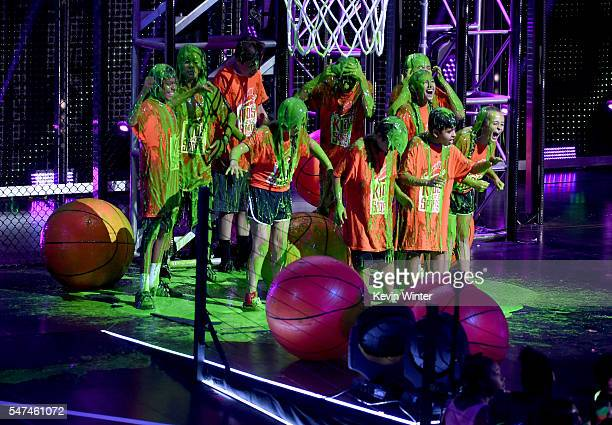 Fans get slimed while participating in a basketball contest onstage during the Nickelodeon Kids' Choice Sports Awards 2016 at UCLA's Pauley Pavilion...