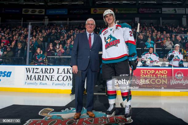 Fans give a standing ovation to Cal Foote of the Kelowna Rockets as he stands next to President and General Manger Bruce Hamilton on the ice against...