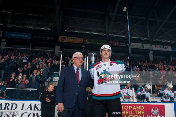 Fans give a standing ovation to Cal Foote of the Kelowna Rockets as he raises his stick next to President and General Manger Bruce Hamilton on the...