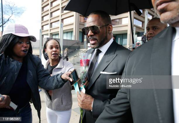 Fans giving singer R Kelly a rose and cards outside the Leighton Courthouse on March 22 2019 in Chicago Illinois R Kelly had appeared before a judge...