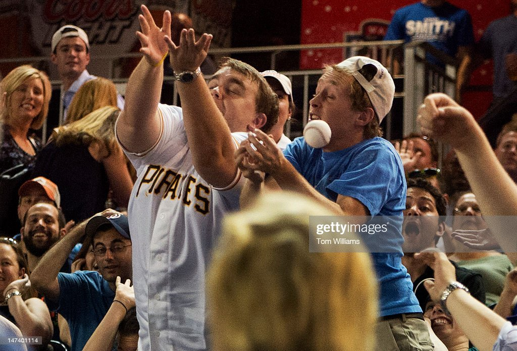 Fans go for a foul ball during the 51st Annual CQ Roll Call Congressional Baseball Game held at Nationals Park. The Democrats prevailed over the Republicans 18-5.