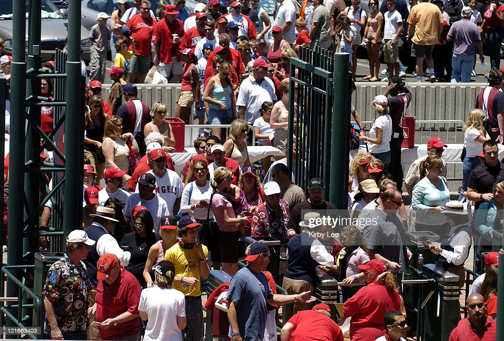 Fans go through a security checkpoint to enter Angel Stadium before Los Angeles Angels of Anaheim game against the Florida Marlins in Anaheim, California on Sunday, June 19, 2005.