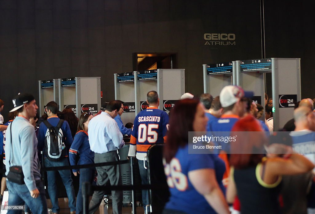 Fans go through metal detectors for the game between the New York Islanders and the New Jersey Devils at the Barclays Center on September 23, 2015 in the Brooklyn borough of New York City.