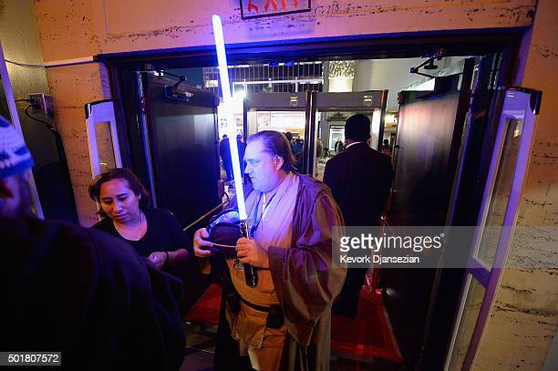 Fans go through security during the opening night of Walt Disney Pictures and Lucasfilm's Star Wars The Force Awakens at TCL Chinese Theatre on...