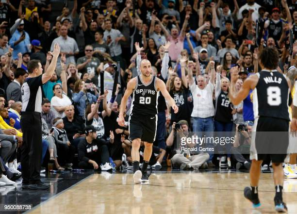 Fans go wild after Manu Ginobili of the San Antonio Spurs hit a three point shot late in fourth quarter against the Golden State Warriors in Game...