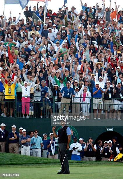 Fans go wild as Tiger Woods sinks an eagle putt on the 18th green to take a 1–stroke lead over Lee Westwood during the third round of the US Open at...