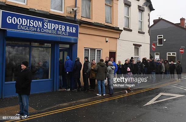 Fans grab a bite to eat prior to kickoff during the Premier League match between Everton and Manchester City at Goodison Park on January 15 2017 in...