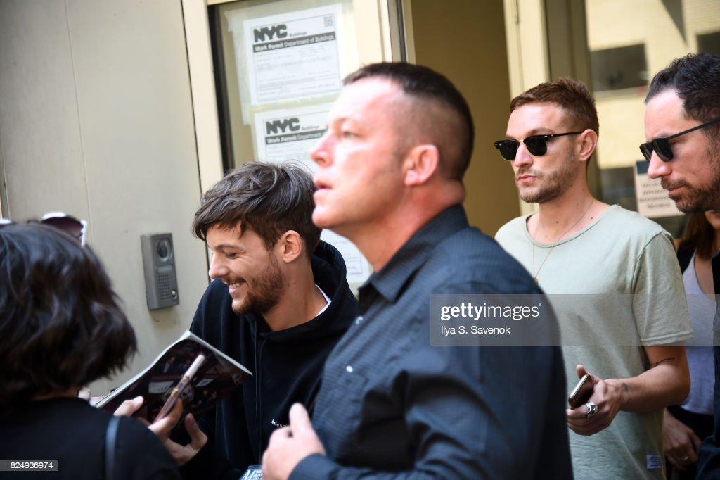 Fans greet Louis Tomlinson at Music Choice on July 31, 2017 in New York City.