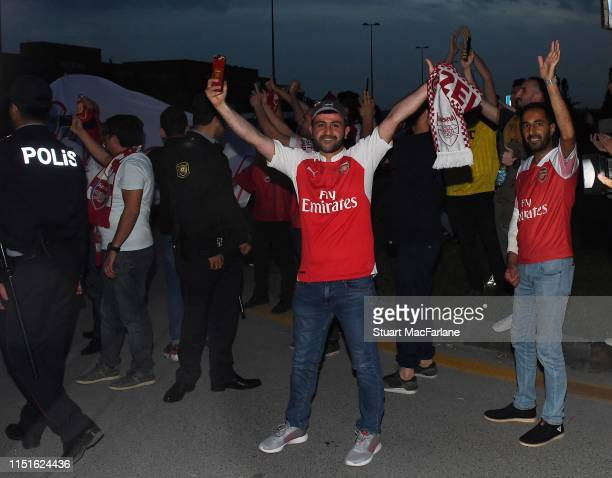 Fans greet the Arsenal fans at Baku Airport on May 25 2019 in Baku Azerbaijan
