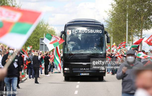 Fans greet The FC Augsburg team bus as it arrives at the stadium prior to the Bundesliga match between FC Augsburg and SV Werder Bremen at WWK-Arena...