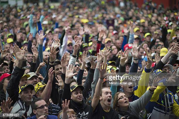 Fans greet the riders during the 'QA in front of fans' at the MotoGp of France Free Practice at on May 15 2015 in Le Mans France