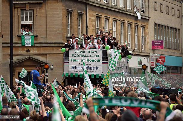 Fans greet the Yeovil Town FC opentop tour bus as its does a celebration parade around the Somerset town on May 21 2013 in Yeovil England The team...