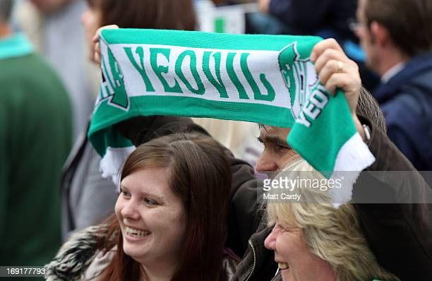 Fans greet the Yeovil Town FC open-top tour bus as its does a celebration parade around the Somerset town on May 21, 2013 in Yeovil, England. The...