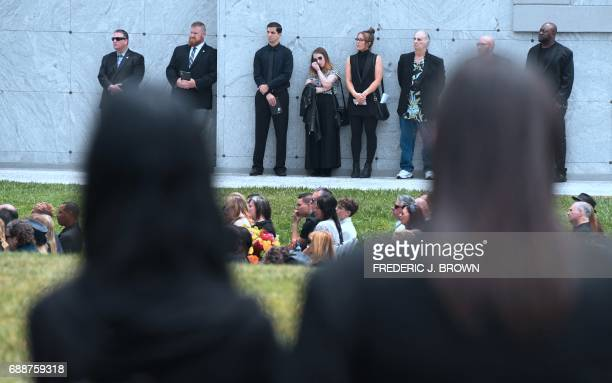 Fans grieve at the funeral service for Soundgarden frontman Chris Cornell on May 26 2017 at the Hollywood Forever Cemetery in Los Angeles California...