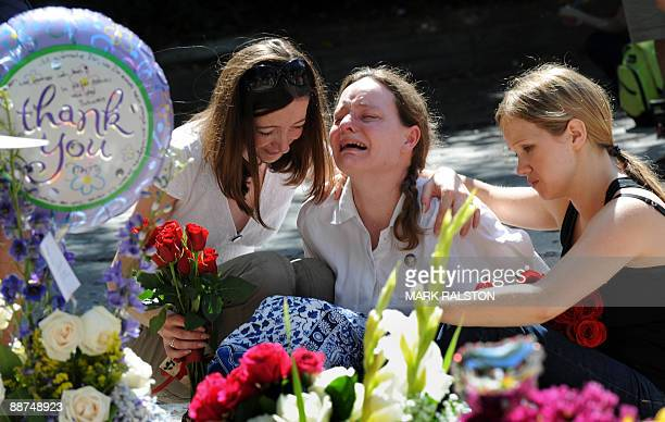 Fans grieve outside the rented Holmby Hills home of music legend Michael Jackson after his recent death in Los Angeles on June 29 2009 Michael...