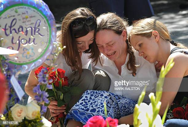Fans grieve outside the rented Holmby Hills home of music legend Michael Jackson after his recent death, in Los Angeles on June 29, 2009. Michael...