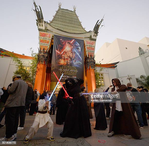 Fans have a light saber battle before the opening night of Walt Disney Pictures and Lucasfilm's Star Wars The Force Awakens at TCL Chinese Theatre on...