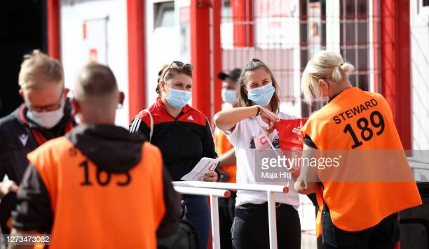 Fans have their bags and tickets checked by stewards ahead of the Bundesliga match between 1. FC Union Berlin and FC Augsburg at Stadion An der Alten...