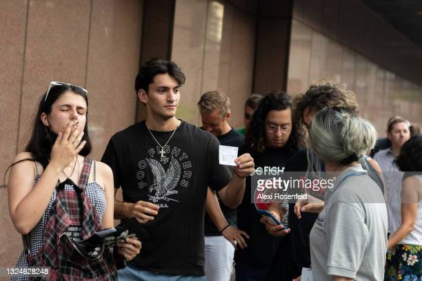 Fans have their COVID-19 vaccination cards checked before entering the Foo Fighters concert at Madison Square Garden on June 20, 2021 in New York...