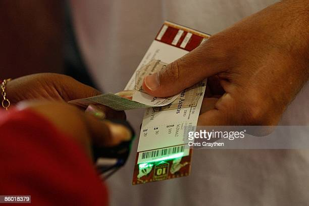 Fans have their tickets scanned as they come into Minute Maid Park before the Chicago Cubs and the Houston Astros Opening Day game on April 6 2009 at...