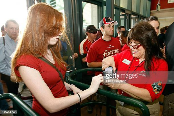 Fans have their tickets scanned on entering the stadium to watch the San Francisco Giants and the Houston Astros on Opening Day at Minute Maid Park...