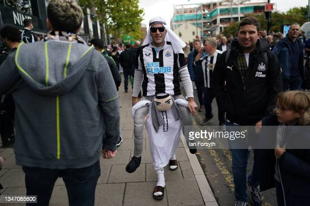 Fans head to St James' Park football stadium before their game against Tottenham Hotspur and their first game after Newcastle United's takeover on...