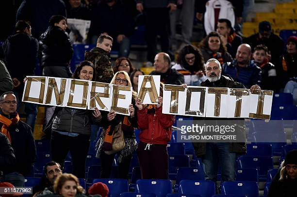 Fans hold a banner dedicated to Italy's Roma forward Francesco Totti during the italian Serie A football match Roma vs Palermo at the Olympic Stadium...
