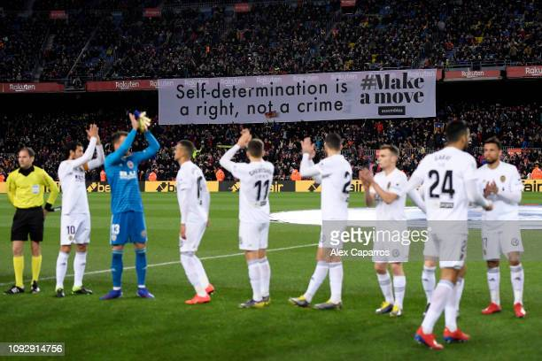 Fans hold a Catalonian banner in the stands during the La Liga match between FC Barcelona and Valencia CF at Camp Nou on February 2, 2019 in...