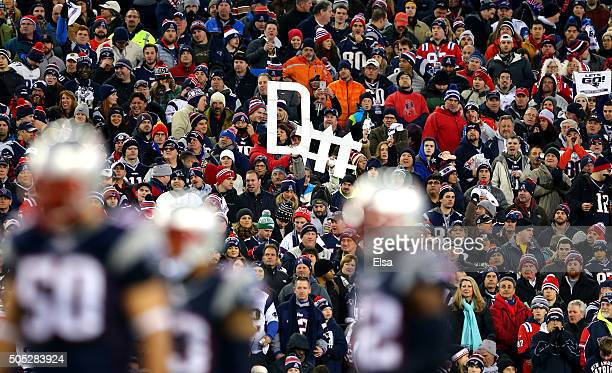Fans hold a defense sign in the first quarter during the AFC Divisional Playoff Game between the Kansas City Chiefs and the New England Patriots at...