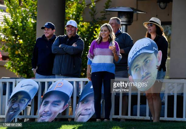 Fans hold a giant Patrick Cantlay head sign on the 18th hole during the final round of The American Express tournament on the Stadium course at PGA...