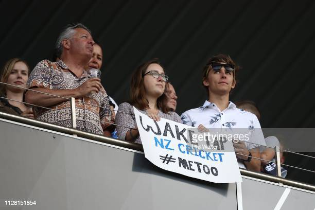 Fans hold a sign at Eden Park referring to the Me Too movement during game two of the International T20 Series between the New Zealand Black Caps and...