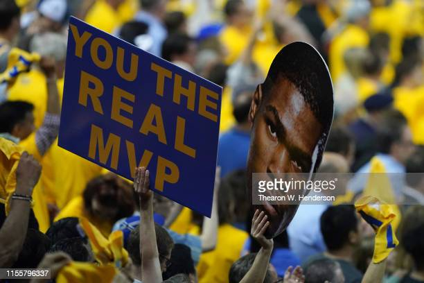 Fans hold a sign for Kevin Durant during Game Six of the 2019 NBA Finals between the Golden State Warriors and the Toronto Raptors at ORACLE Arena on...