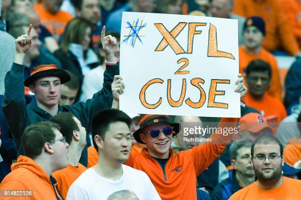 Fans hold a sign for the XFL prior to the game between the Virginia Cavaliers and the Syracuse Orange at the Carrier Dome on February 3 2018 in...