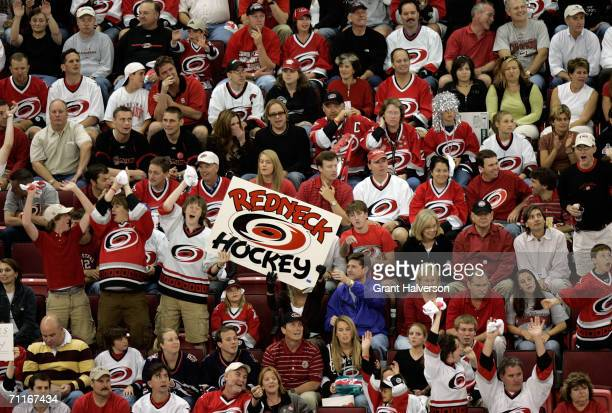 Fans hold a sign in support of the Carolina Hurricanes during game two of the 2006 NHL Stanley Cup Finals against the Edmonton Oilers during on June...