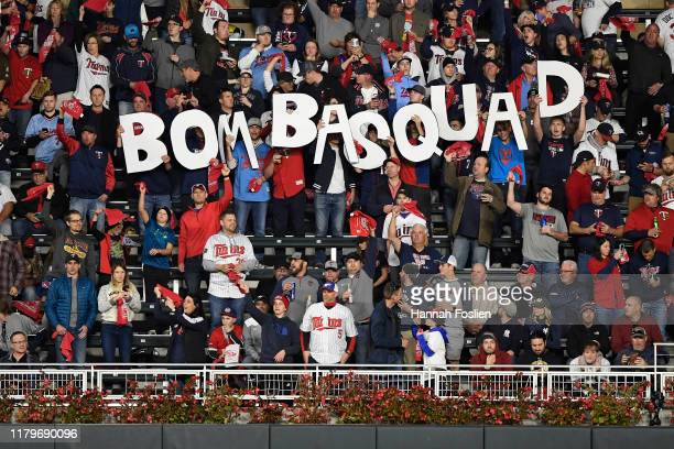 Fans hold a sign prior to game three of the American League Division Series between the New York Yankees and the Minnesota Twins at Target Field on...