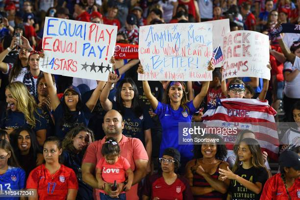 Fans hold a women's rights and equal pay sign up during the USA Victory Tour match between the United States of America and the Republic of Ireland...