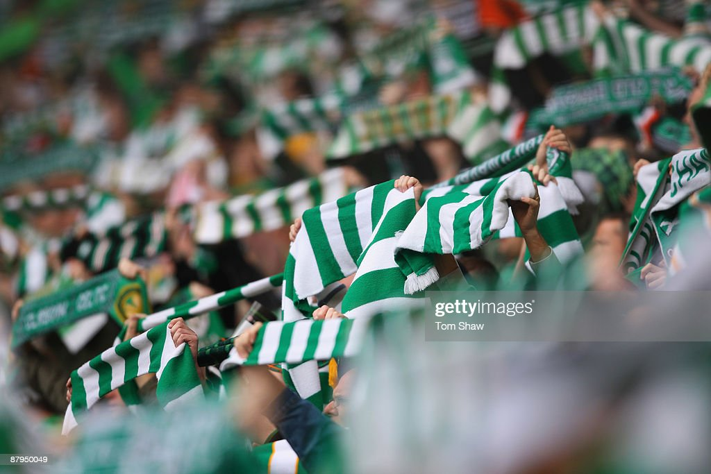 Fans hold aloft green scarves during the Scottish Premier League match between Celtic and Hearts at Parkhead on May 24, 2009 in Glasgow, Scotland.