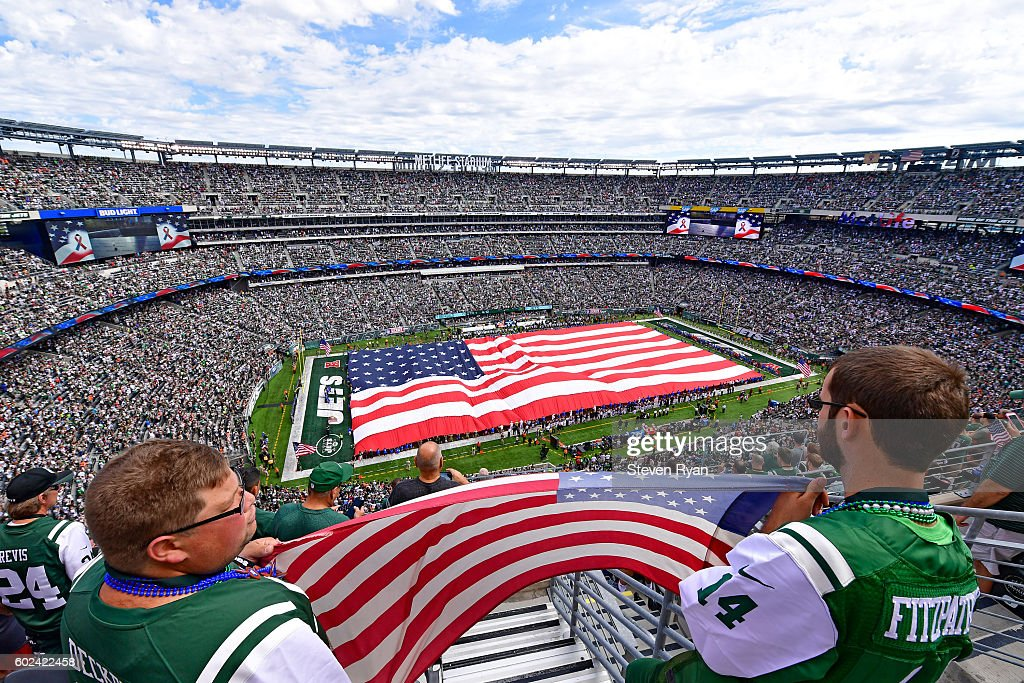 Fans hold an American flag during the National Anthem prior to the game between the New York Jets and the Cincinnati Bengals at MetLife Stadium on September 11, 2016 in East Rutherford, New Jersey.