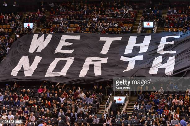 """Fans hold big banner """"We the north"""" before the Toronto Raptors vs Brooklyn Nets NBA regular season game at Scotiabank Arena on January 11..."""
